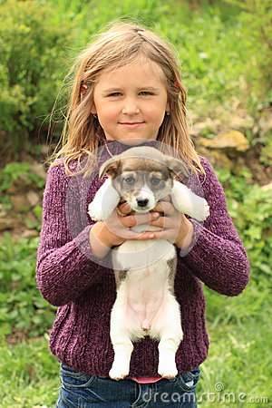 Little girl holding a puppy