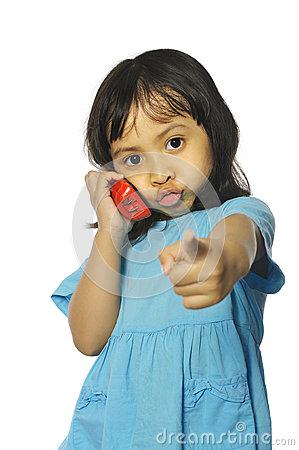 Little girl holding red wireless telephone