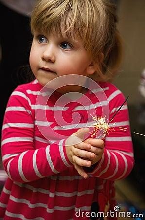 Little girl holding sparkler