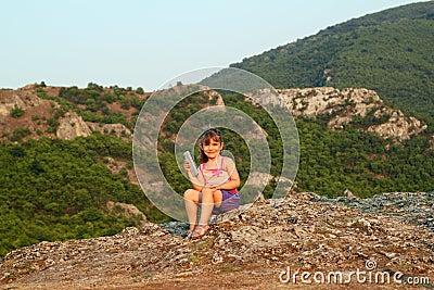 Little girl holding tablet