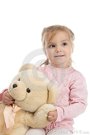 Little girl holding a teddy bear