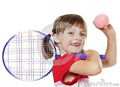 Little girl holding a tennis racket and ball