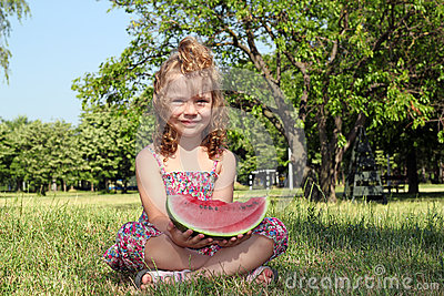 Little girl holding watermelon