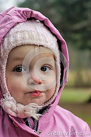 Little girl in hooded coat