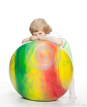 Little girl with a huge fitball