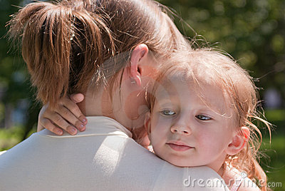 Little girl hugging her mother s neck