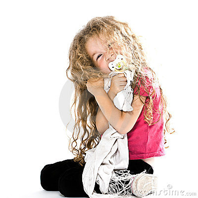 Little girl hugging pacifier blanket smiling