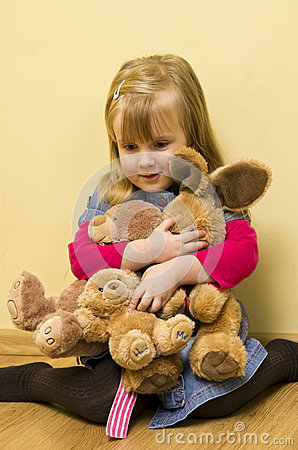 Little Girl Hugging Stuffed Animals