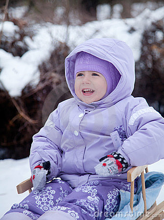 Free Little Girl In A Winter Park On A Sled Stock Photo - 23655320