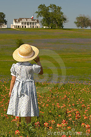 Free Little Girl In Field Of Flowers With House Stock Photo - 5051230
