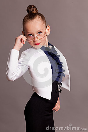 Free Little Girl In Glasses Dressed As Business Lady Stock Photography - 76480062