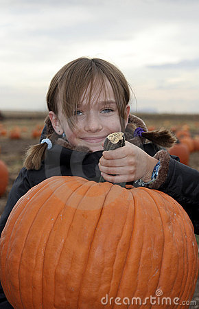 Free Little Girl In Pumpkin Patch Stock Images - 1160734