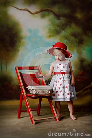 Free Little Girl In Red Dress With Egg Basket Royalty Free Stock Photos - 43982608