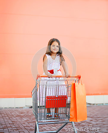 Free Little Girl In Shopping Cart Outdoors Royalty Free Stock Photos - 53848318
