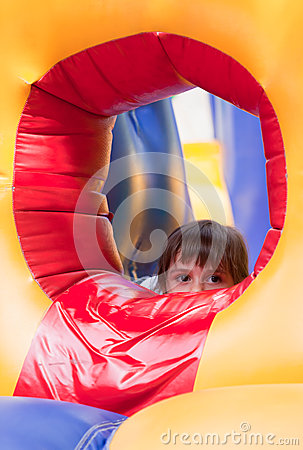 Little girl on inflatable slide