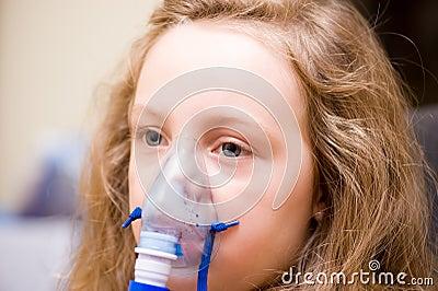 Little girl inhaling