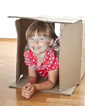Little girl inside a cardboard box