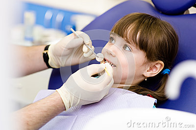 Little girl during inspection of oral cavity Stock Photo