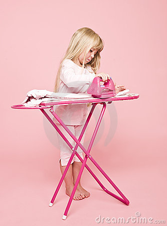 Little girl ironing dress