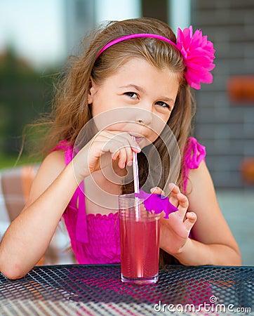 Free Little Girl Is Drinking Cherry Juice Stock Photos - 47081073