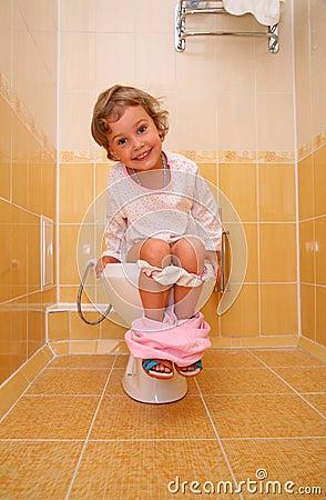 Free Little Girl Is Sitting On Toilet Stock Photo - 6581770