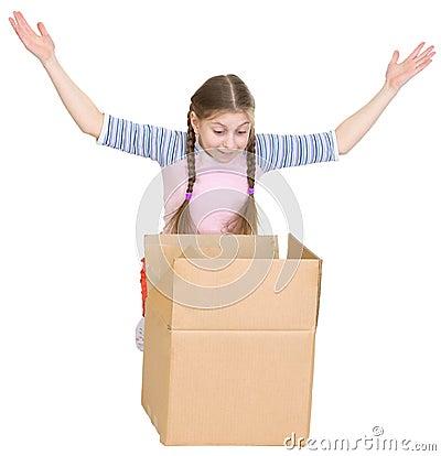 Little girl joyfully looks in a box