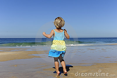 Little girl jumping on the beach