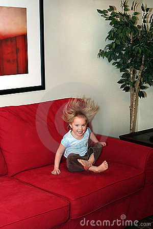 Little Girl Jumping on Couch