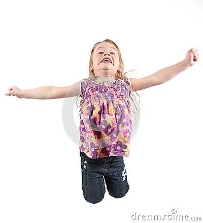 Little girl jumping for joy