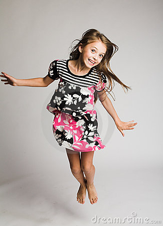 Little girl jumping of joy
