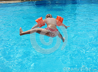Little Girl Jumping Into The Pool Stock Photo Image 58743314