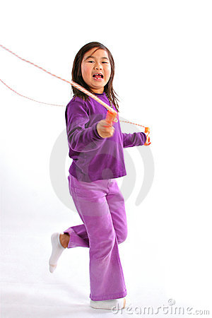 Little Girl Jumping with Rope