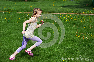 Little girl jumping, running
