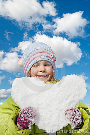 little girl keeps in hands snow hearts