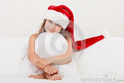 Little girl kid in santa claus hat christmas stock photo image