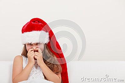 Little girl kid in santa hat giggling christmas stock photo image