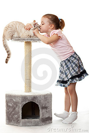 Little girl kisses her cat.