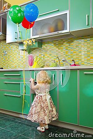 Little girl on kitche