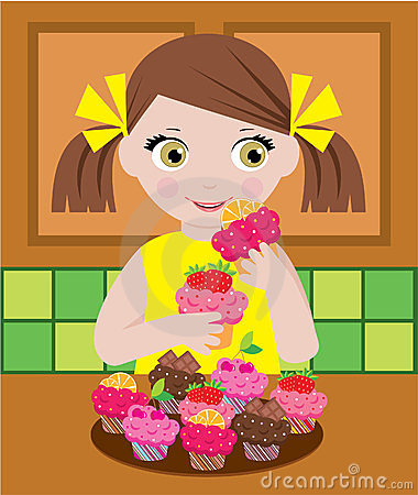 Little girl in kitchen with cupcakes