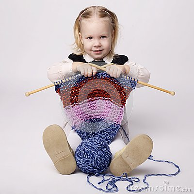 Free Little Girl Knitting Scarf Stock Photography - 37782332