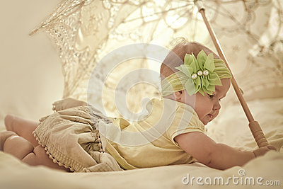 Little girl with lace umbrella