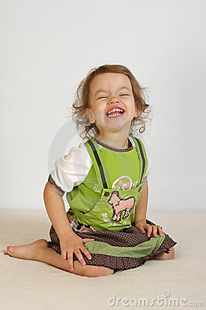 A little girl laughs.