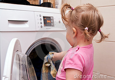 Little girl and laundry