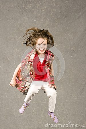Little girl leaping into air
