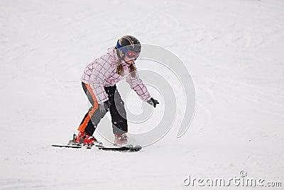 Little girl learning alpine skiing