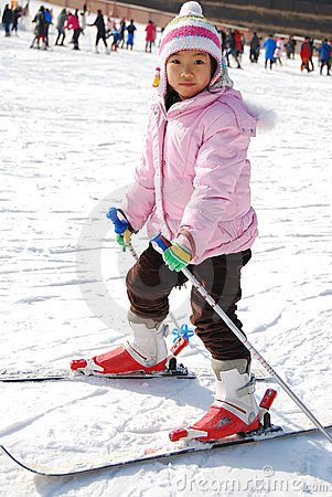 Little girl learning skiing