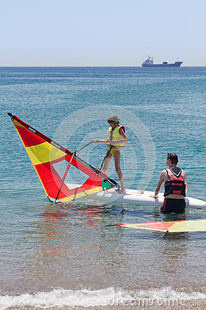 Free Little Girl Learning Windsurfing Royalty Free Stock Photo - 44035545