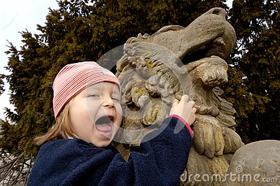 Little girl and lion