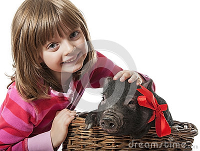 A little girl with a little black pig