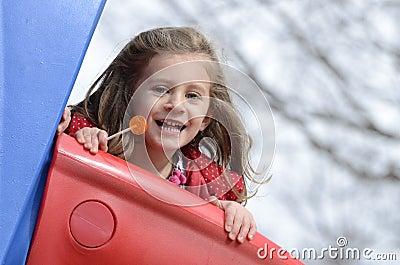Little girl and lollipop